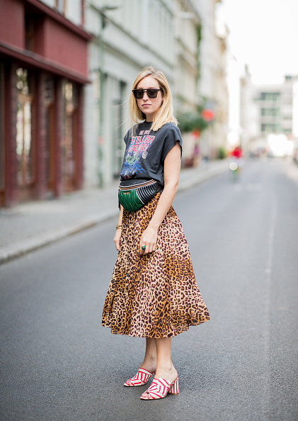 BERLIN, GERMANY - JUNE 04: Sonia Lyson wearing red white striped mules Edited, midi plaid skirt with leo print &other stories, tshirt with galaxy print Zara, Dior sunglasses, Dior earings, Miu Miu belt bag on June 4, 2018 in Berlin, Germany. (Photo by Christian Vierig/Getty Images)